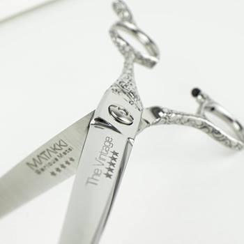 hairdressing scissors close up image of decorative design